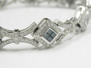 4.11 TCW Blue and White Round and Princess Cut Diamond Tennis Bracelet 14k