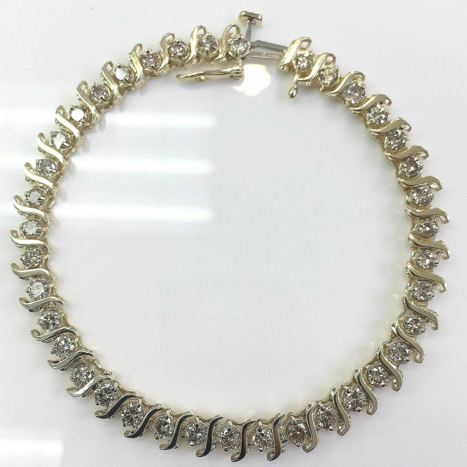 3.32 Carats t.w. Diamond S Tennis Bracelet 14K Gold 11.6 Grams