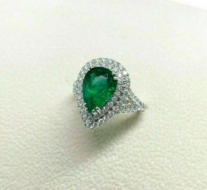 4.02 Carats t.w. Diamond and Emerald Halo Ring 18K Gold Emerald is 2.85 Carats