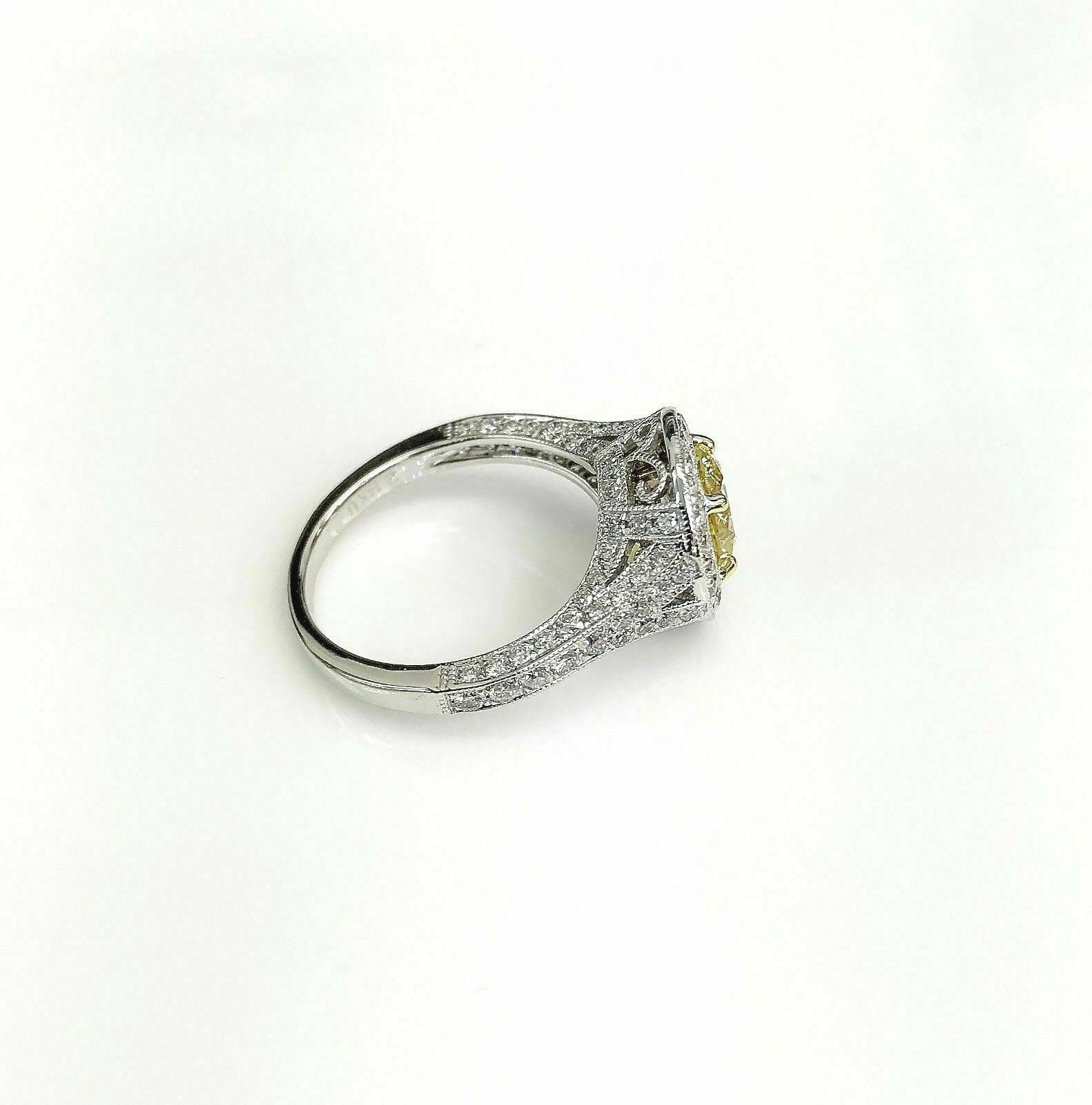 2.10 Carats t.w. Fancy Yellow Diamond Halo 3 Sided Pave Engagement Ring 18k