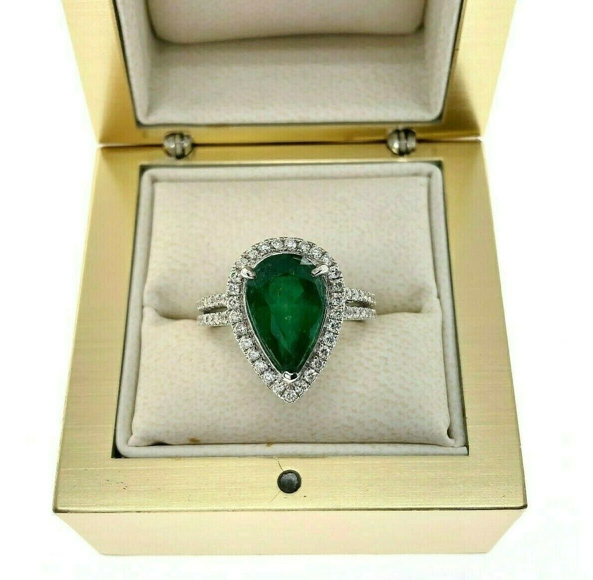 3.82 Carats t.w. Diamond and Emerald Halo Ring 18K Gold Emerald is 3.25 Carats