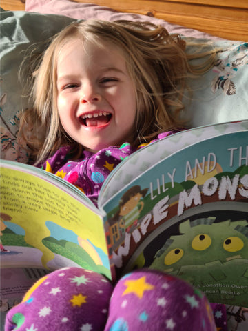 Girl reading Lily and The Wipe Monster
