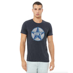 A guy wearing a Vintage Heather Navy T-Shirt with a two toned blue graphic of the Blue Star Highway logo on it.