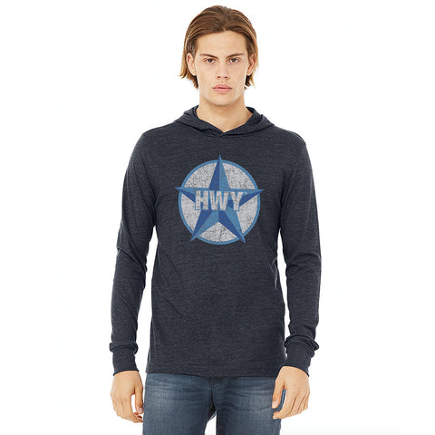 A guy wearing a Vintage Heather Navy Long Sleeve Hoodie T-Shirt with a two toned blue graphic of the Blue Star Highway logo on it.