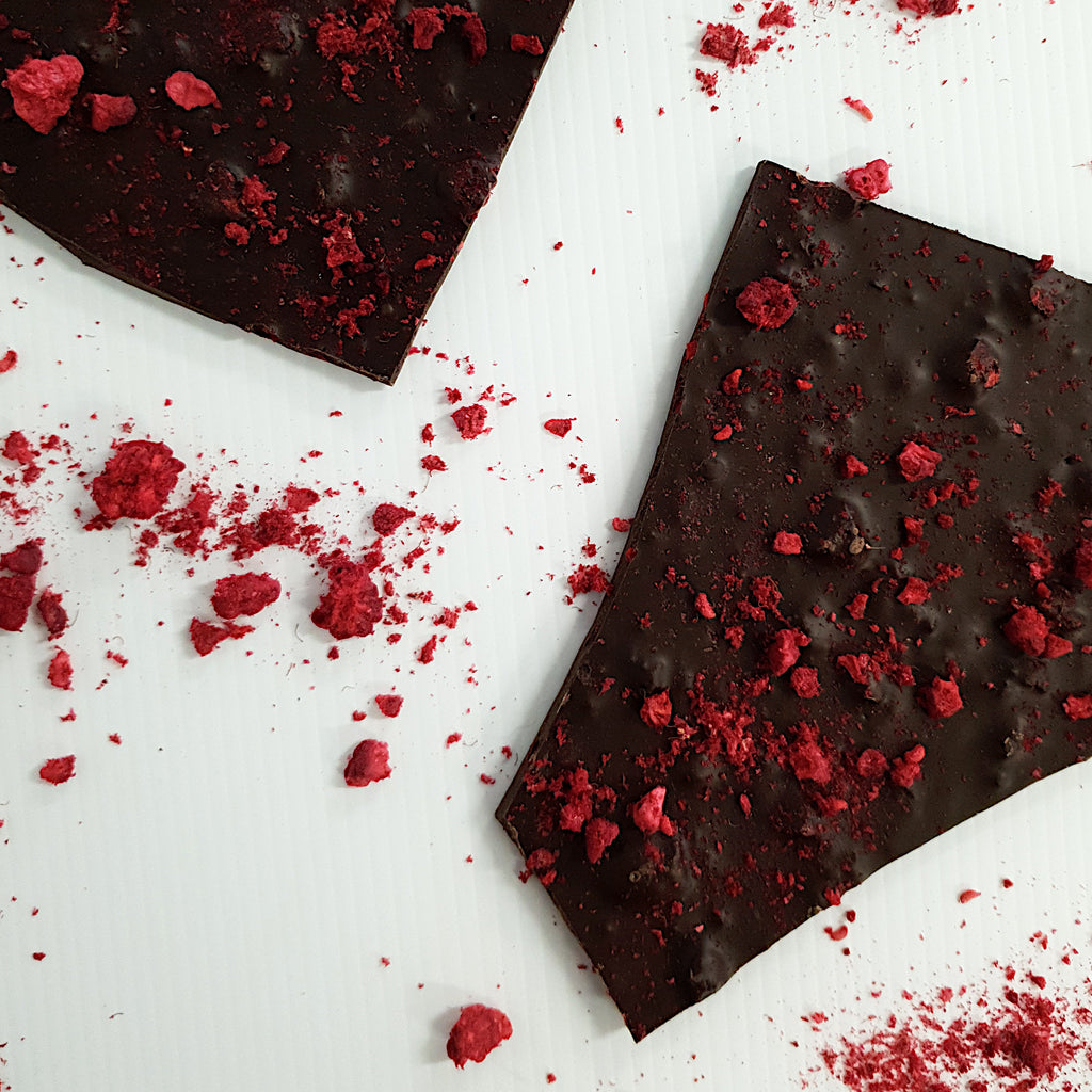 Callebaut 70% extra dark chocolate shards. Thin bark flavoured with freeze dried crushed raspberries. Handmade at Woodstock chocolate co in Milton on the New South Wales South Coast.