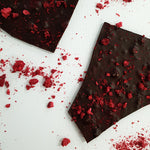 Load image into Gallery viewer, Callebaut 70% extra dark chocolate shards. Thin bark flavoured with freeze dried crushed raspberries. Handmade at Woodstock chocolate co in Milton on the New South Wales South Coast.