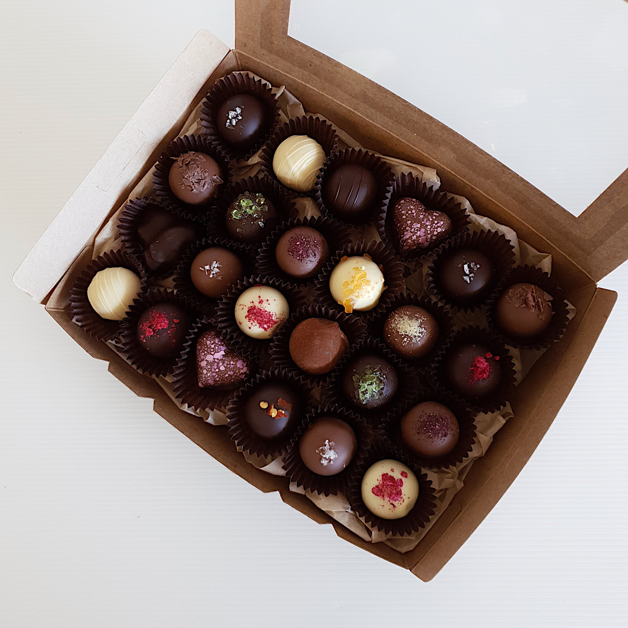 Truffle gift box. Handmade Belgian chocolate truffles in assorted flavours. Lemon, salted caramel, peppermint, lavender, raspberry, chilli lime, hibiscus, Irish cream and more. Made at Woodstock Chocolate Co in Milton, on the south coast of NSW