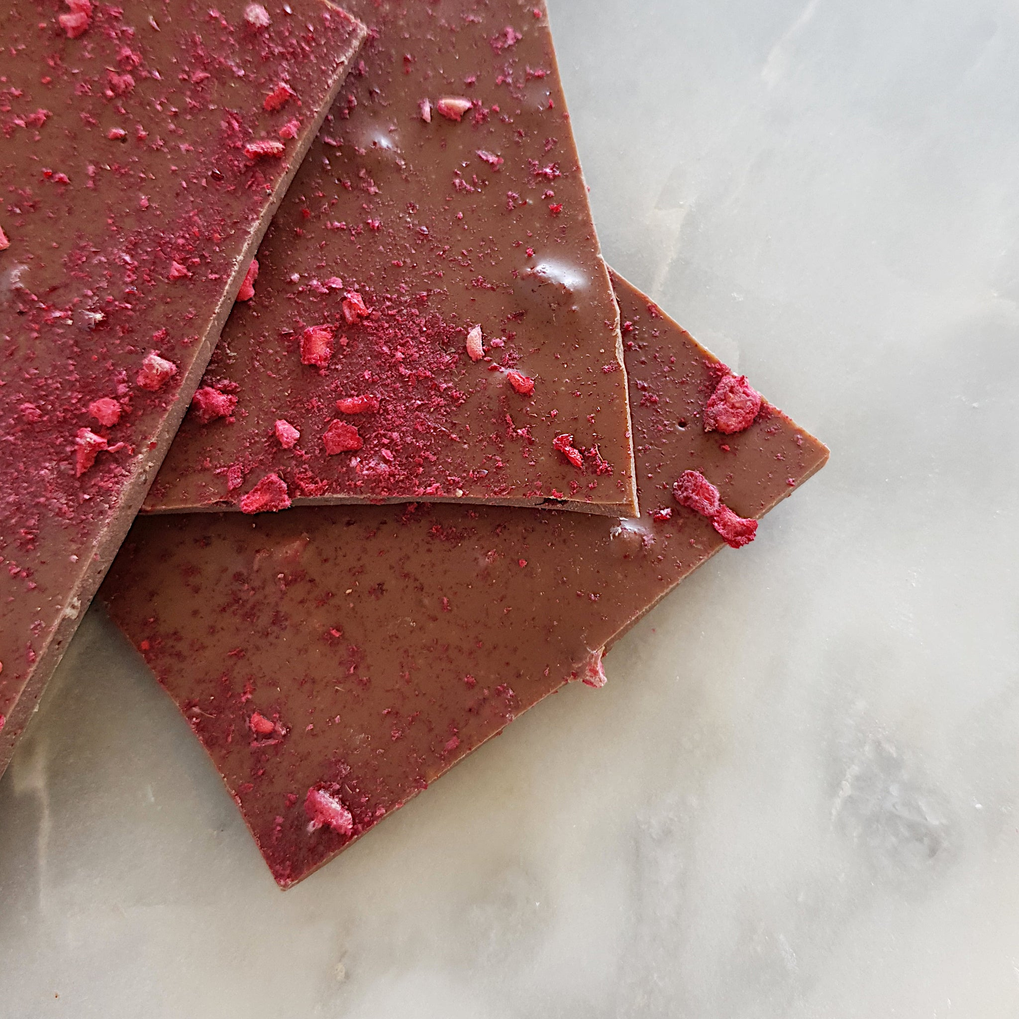 Milk chocolate raspberry bark made using Callebaut Belgian couverture chocolate. Handmade in Milton NSW by local chocolate shop Woodstock Chocolate Co.
