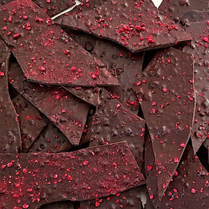 Extra dark chocolate with raspberry flavour. Australian freeze dried raspberries mixed through couverture Belgian chocolate shards. Made by Woodstock chocolate co on the south coast of New South Wales.