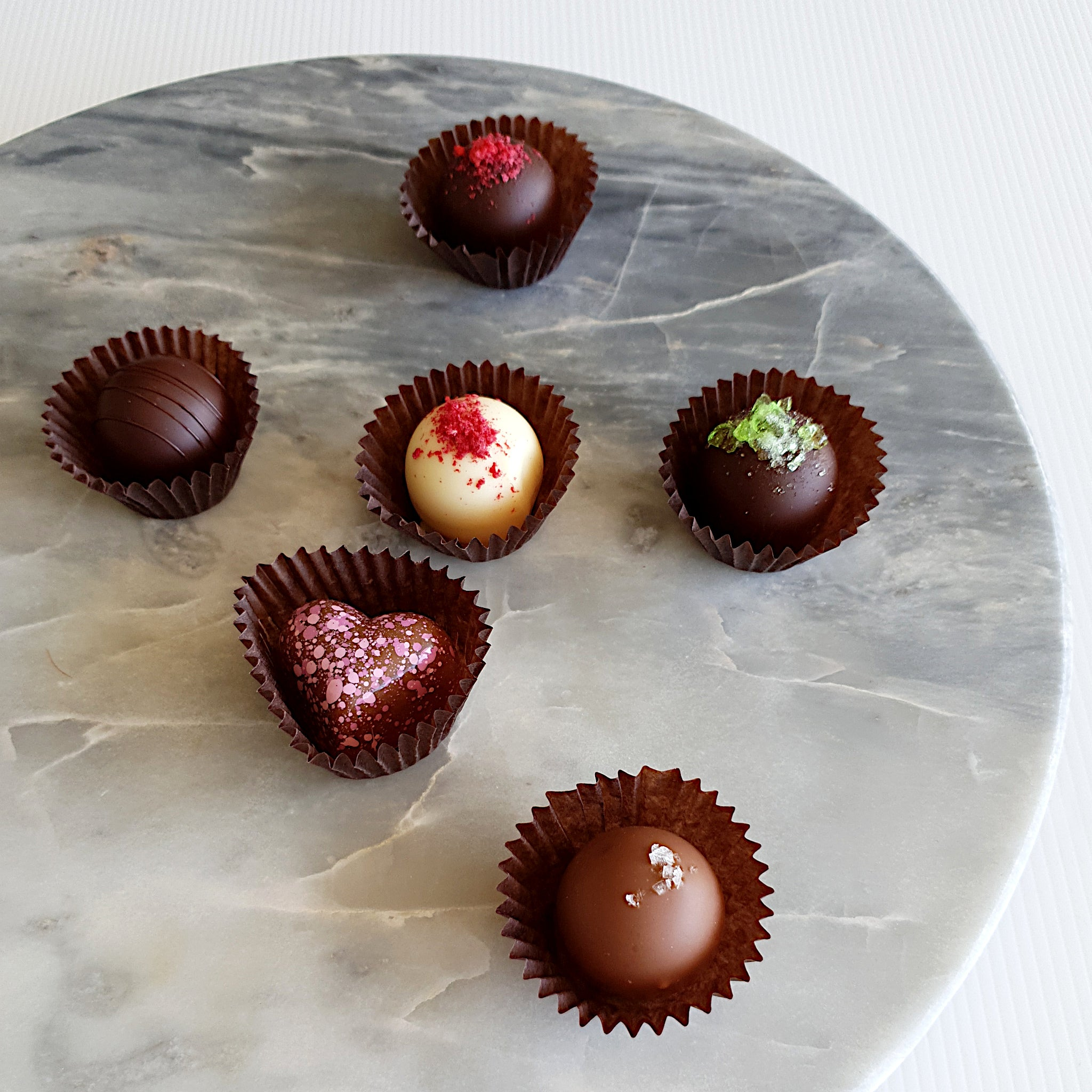Belgian chocolate truffles, handmade in Milton NSW. Flavours include raspberry, peppermint, salted caramel, orange and lavender.