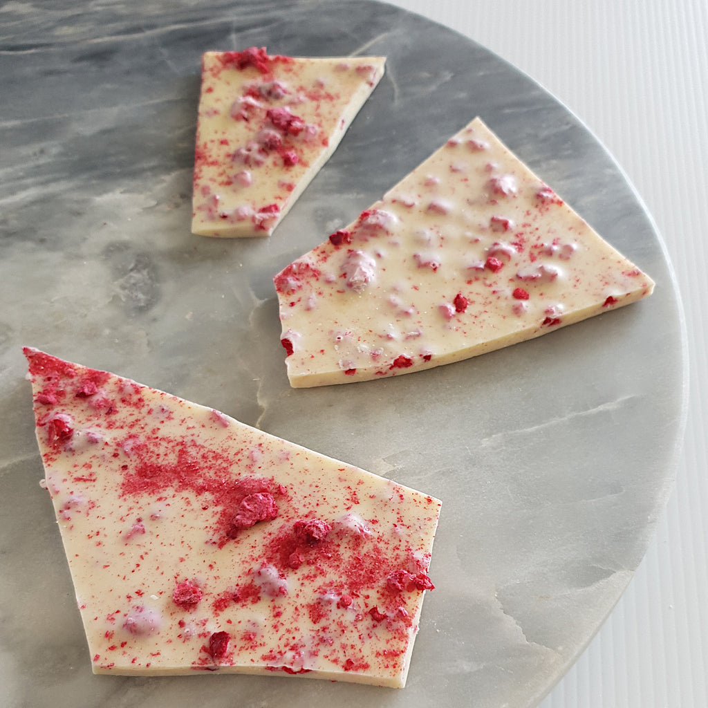 White chocolate bark flavoured with Australian freeze dried raspberries and mint oil. Made using Callebaut Belgian couverture white chocolate in Milton NSW at Woodstock Chocolate Co. Available in 100g bags.