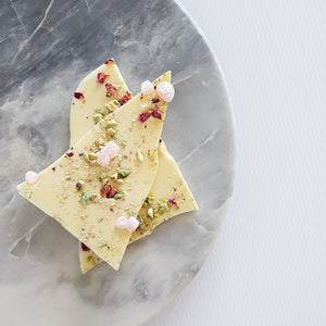 White chocolate shards topped with Turkish delight pieces, crushed pistachio and organise rose petals. Made with Callebaut Belgian couverture white chocolate in Milton NSW at Woodstock Chocolate Co.