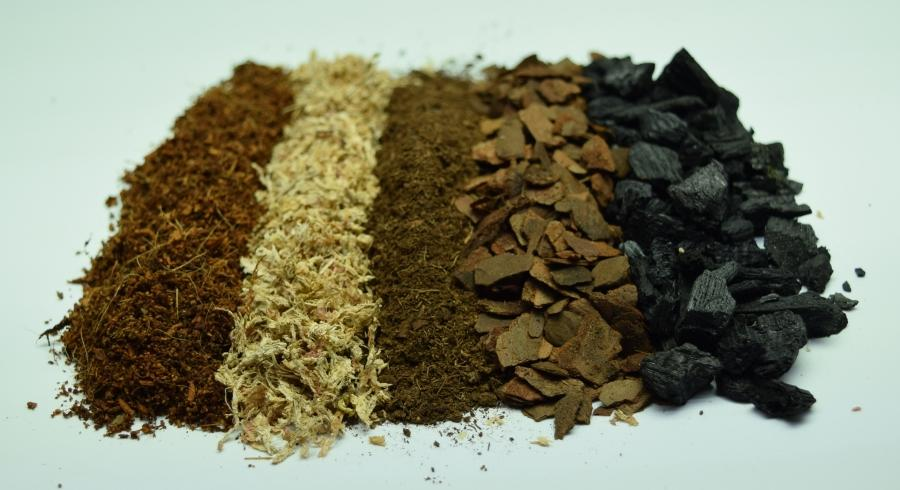 Coconut Coir, Sphagnum moss, Sphagnum peat moss, bark chips, and charcoal.