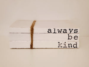 """always be kind"" book stack"
