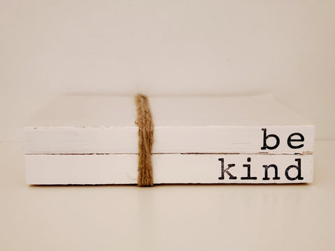 """be kind"" book stack"