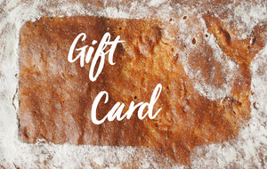 "Gift Card - a stenciled whale on a bread; inside the whale the text ""gift card"""