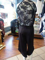 Black Sleeveless Capri Jumpsuit with Sheer Leaf Patterned Back and Asymmetrical Hem