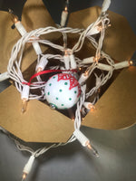 Small Hand Painted White Glass Ornament with Red and Green Henna Art