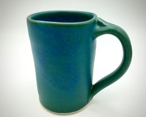 Tall green mugs