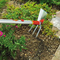 Loosen the soil with WOLF GARTEN Multi-change Duo-hoe with Straight Blade