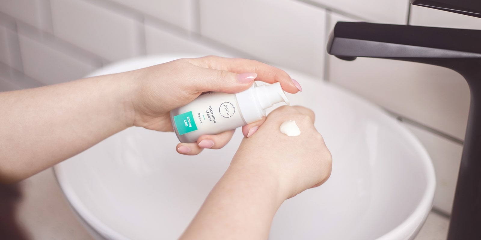 Poko Soothing Serum being applied onto a woman's hand
