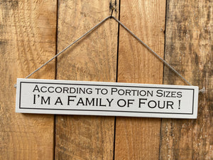 "Sign - ""According to portion sizes I'm a family of four"""