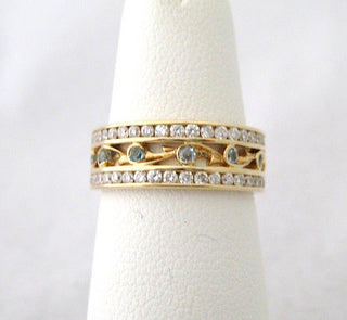 Eternity Band with Double Row of Channel Set Diamonds and Blue Topaz