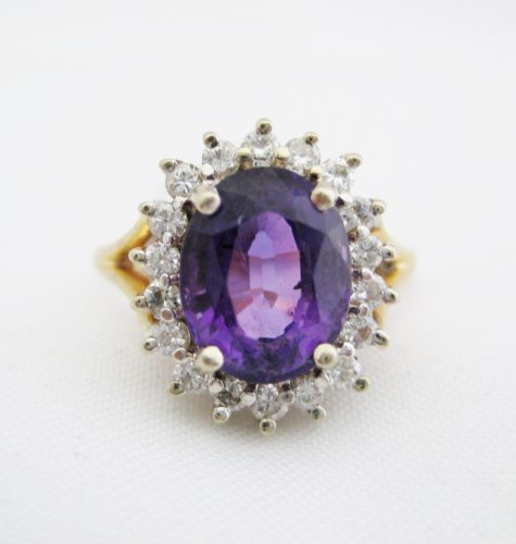 Oval Amethyst Surrounded by Diamonds Ring