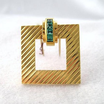 Tiffany & Co. Emerald and Gold Pin, Buckle Motif