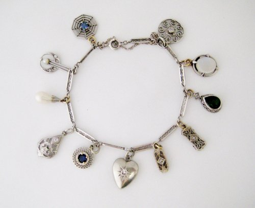 Platinum and Gold Charm Bracelet