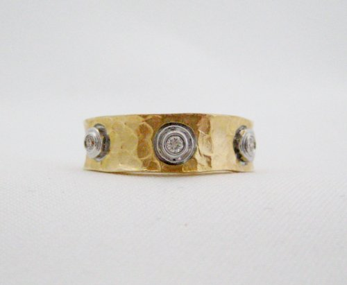Gold Textured Wide Band Containing 3 Bezel Set Diamonds