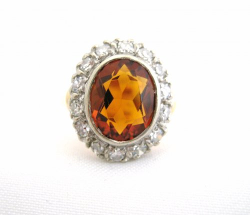 Mid Century Oval Citrine Ring Surrounded by Diamonds