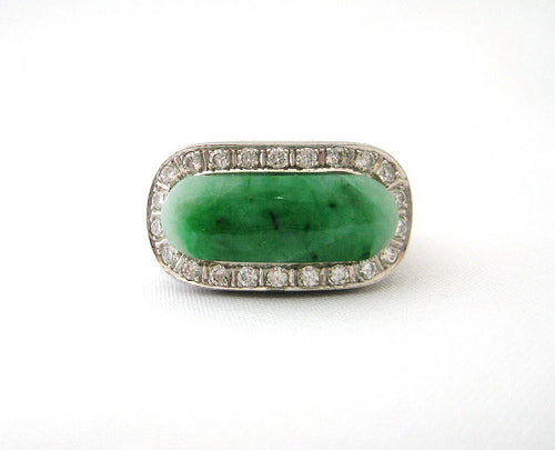 Oblong Jade Ring Framed by Diamonds