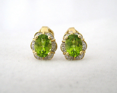 Oval Peridot Surround by Diamond Huggie Earrings