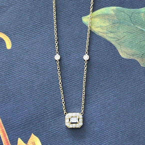 Alluring Diamond Necklace with Emerald cut center diamond