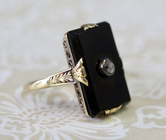 Striking ~ Antique Onyx Ring with Rose cut center diamond