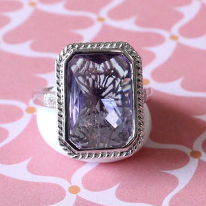 Colorful ~ Sterling Ring with lovely purple center stone