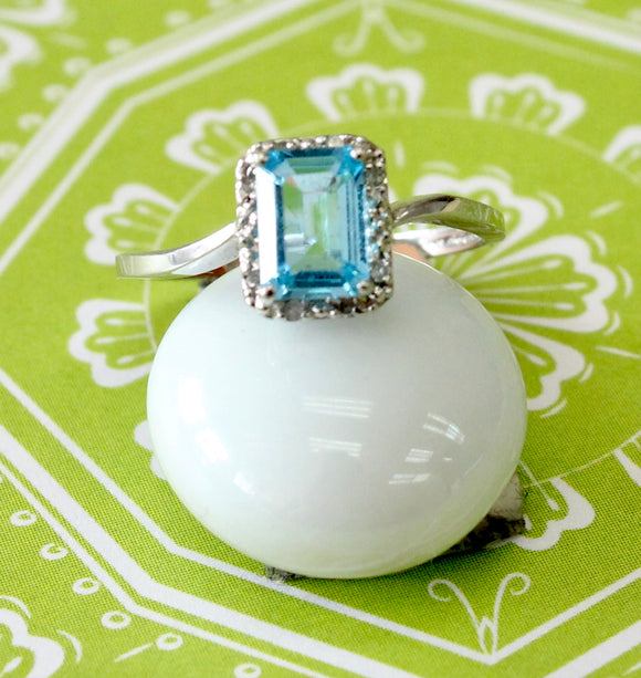Dainty ~ Blue Topaz ring with diamond accents