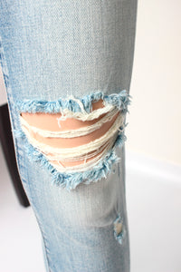 midrise distressed hem jean