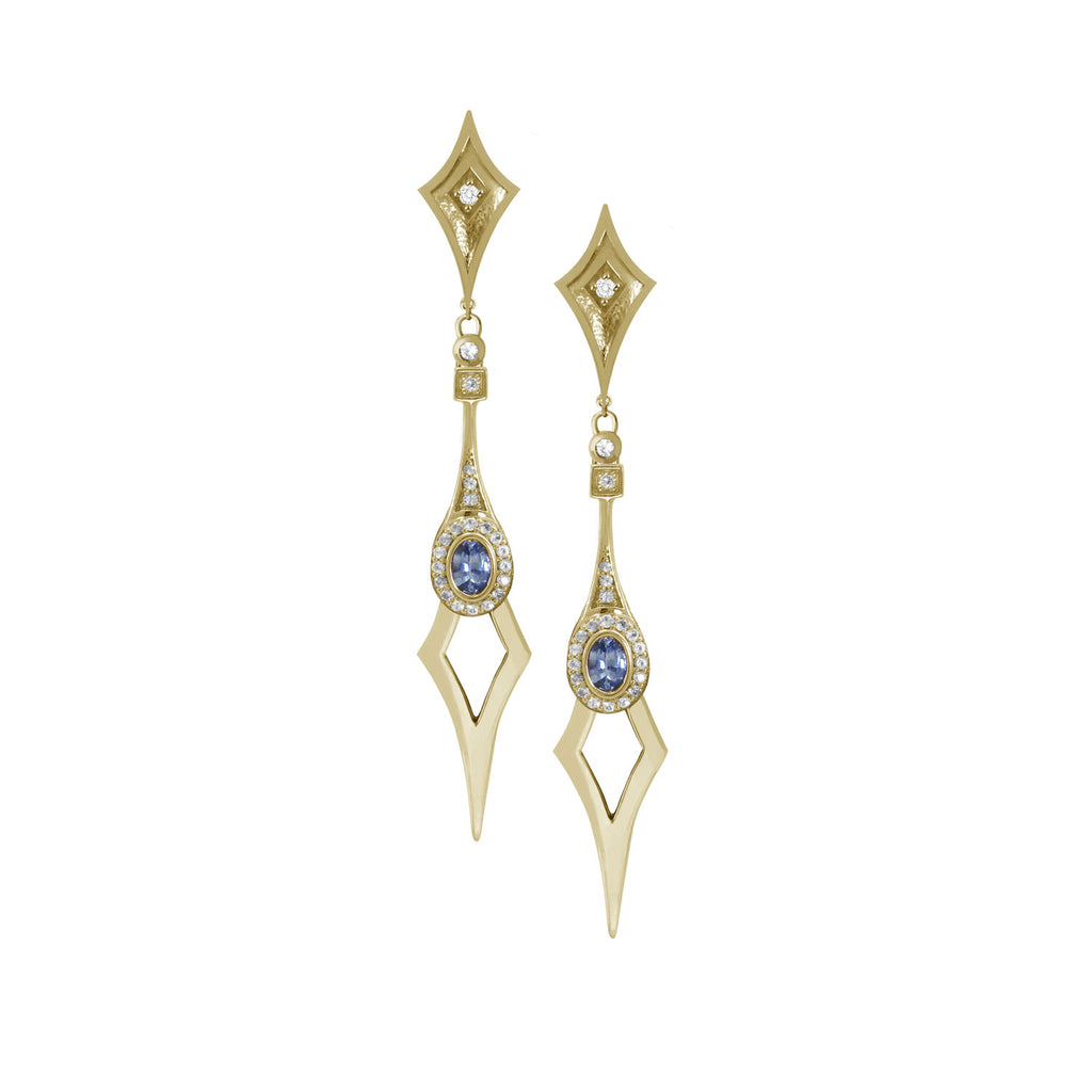 18 karat yellow gold statement drop earrings with a shield-shaped stud with a diamond. The Drop part of the earring is a pale blue sapphire and diamond halo finished with a n elongated point.