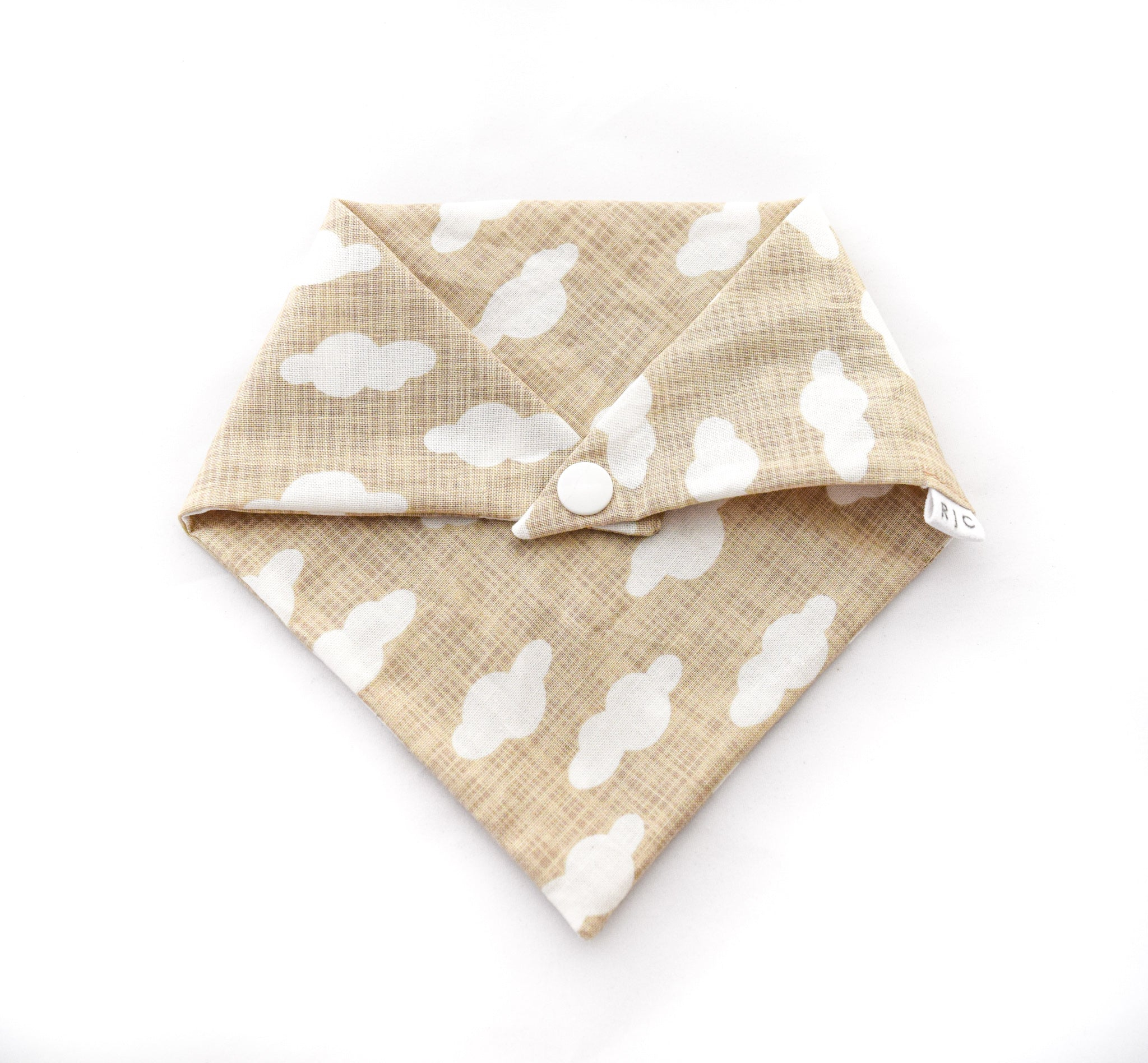 beige cotton dog bandana with white cloud print
