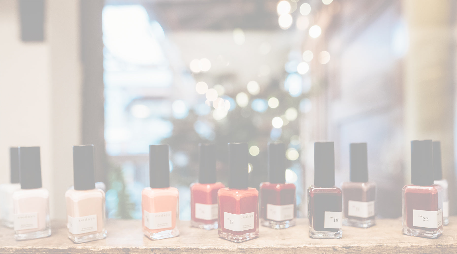 All natural nail polish display in front of window