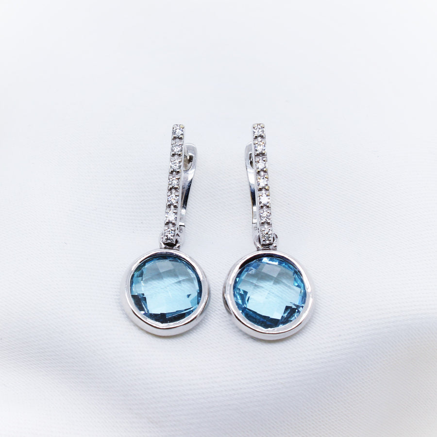 Breuning - 9K White Gold Blue Topaz and Diamond Earring - The French Door Jewellers
