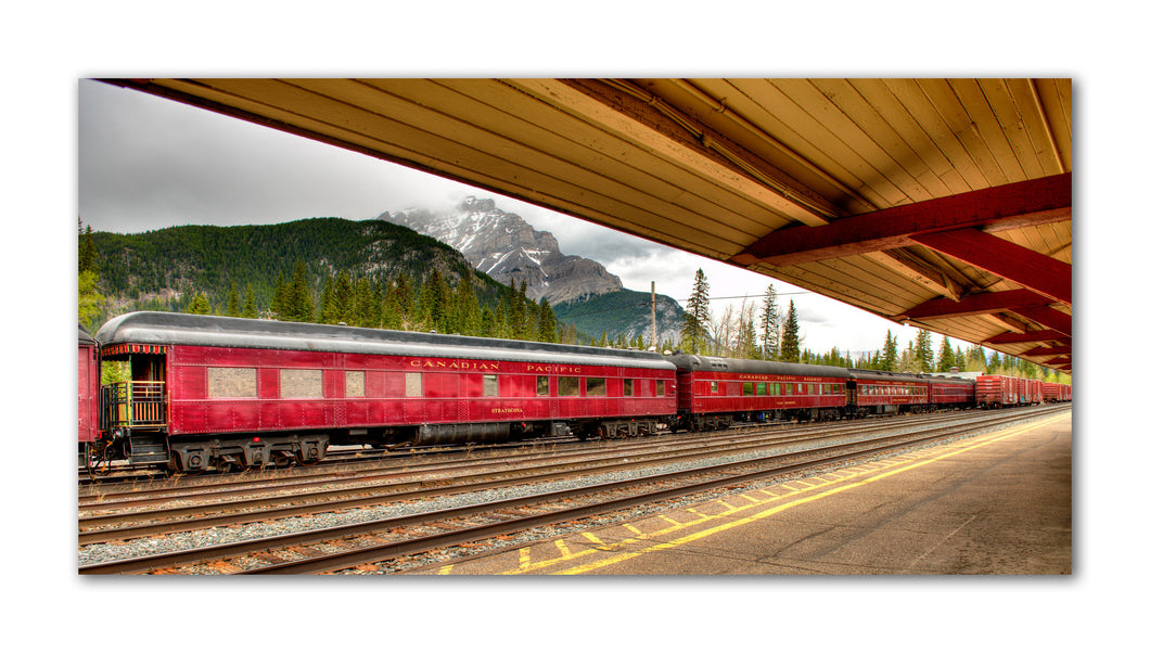 Take walk back into history with this photo of a historic old diner train car sitting at the Banff train station