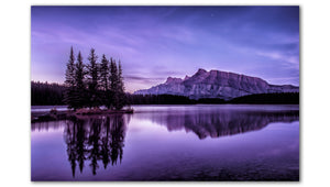 The purple hues in this morning photo of Two Jack lake reminds us of the crisp air captured at sunrise at Two Jack Lake Alberta reminds us of Refrshing Clarity