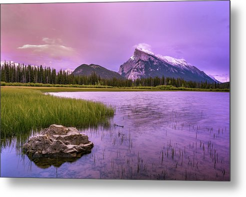 The sky lit up with pastel colors at Vermillion lakes in Banff Alberta to make a picture perfect capture - ready to hang this photo on your wall to proudly show off it's snow capped mount Rundle