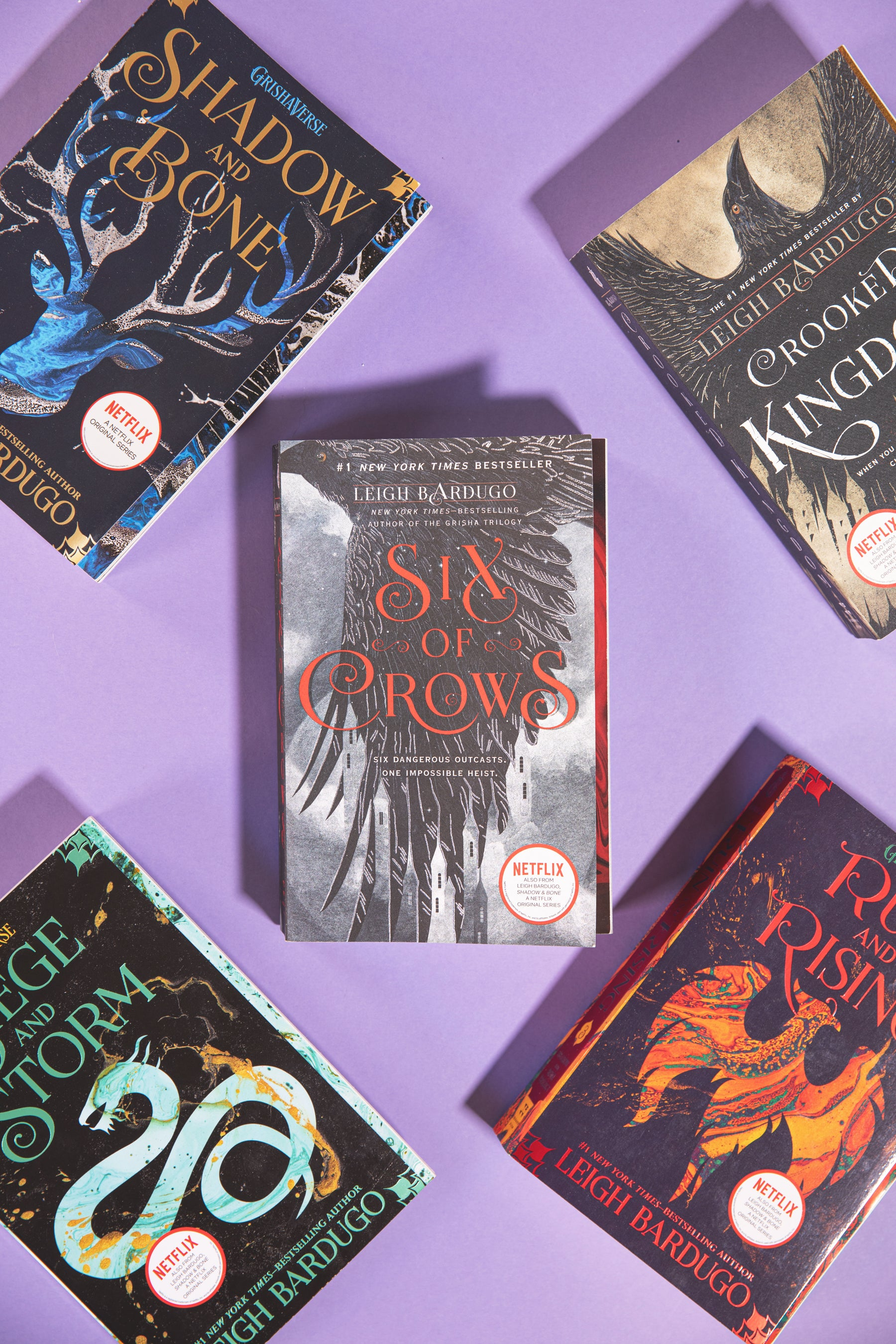 Six of Crows book, with the full Grishaverse series by Leigh Bardugo