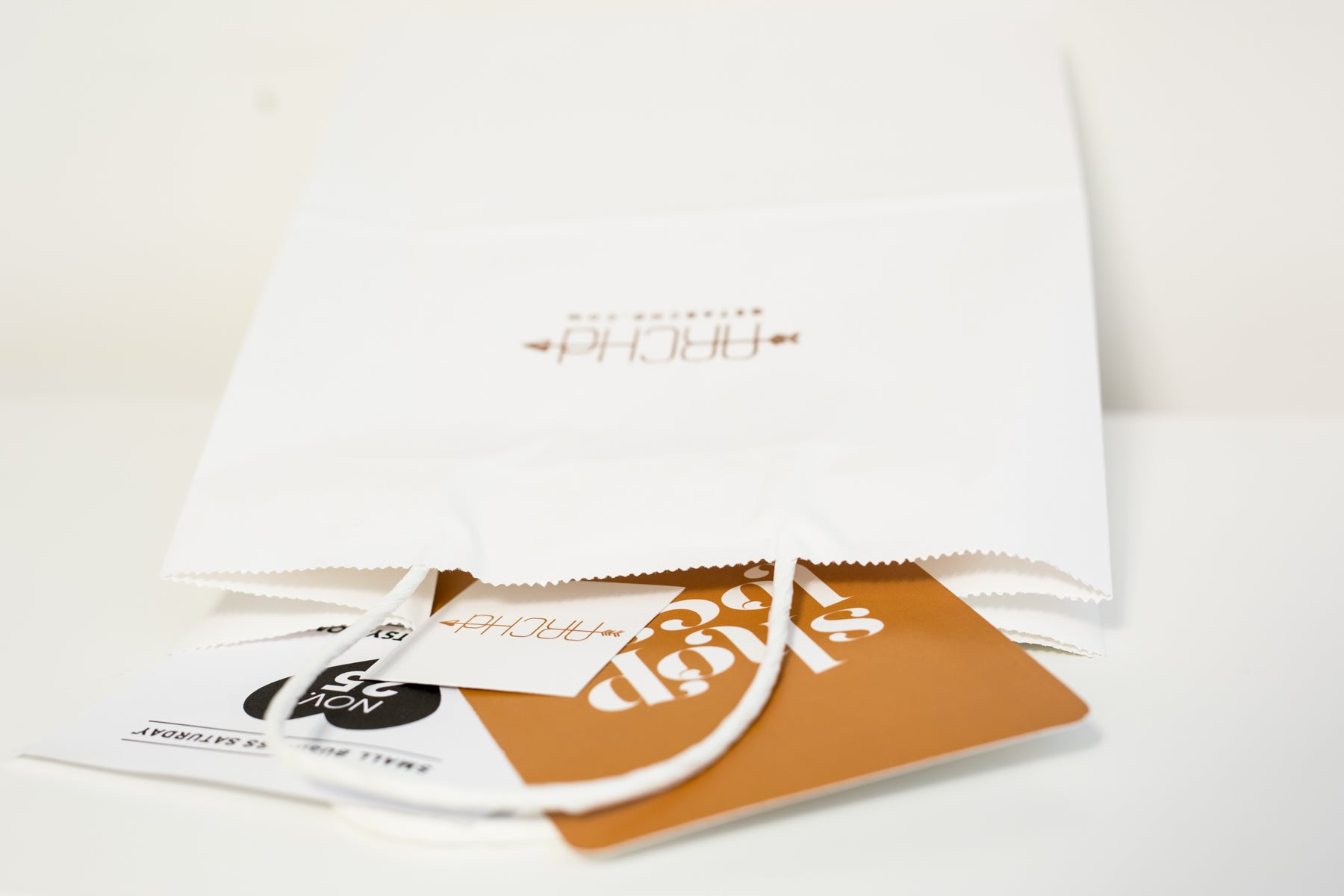 Vendor booth idea tip stamp logo on white paper bags for customers ARCHd