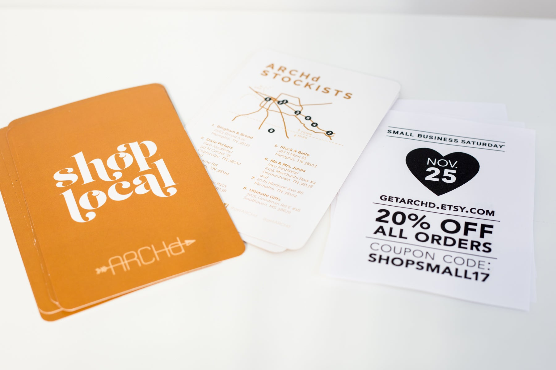 Vendor booth swag flyers design ideas where to shop local sign coupon branding ARCHd
