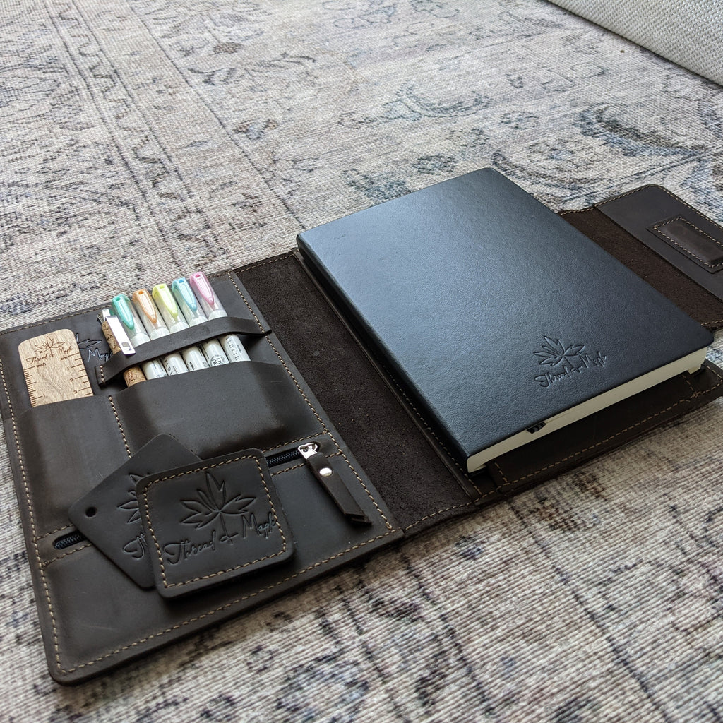 brown leather folio for leuchtturm notebook with zebra highlighters, needle gauge ruler and bamboo pen